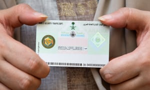 Hamsa al-Sonosi holds up her newly issued driving licence