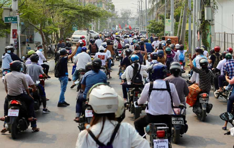 Motorcycle riders protest in Mandalay for an end to the military junta.