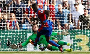 Ben Foster saves from Wilfried Zaha to preserve West Brom's lead.