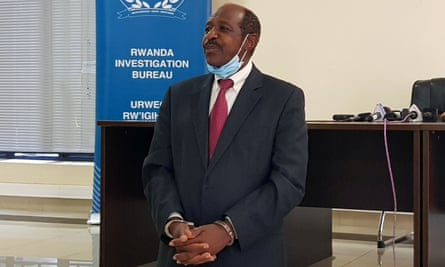 Paul Rusesabagina is detained in front of media in handcuffs in Kigali, Rwanda.