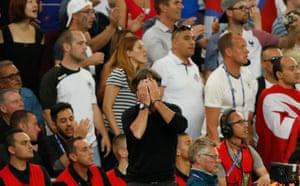Joachim Low can't bear to watch as his team fail to convert their chances.