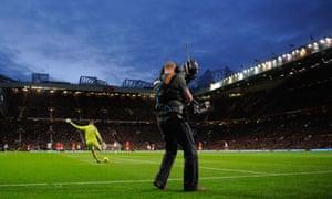 A TV cameraman films a match.