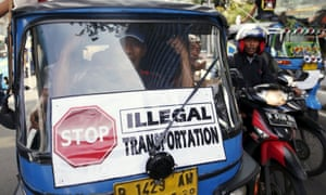 A traditional bajaj taxi takes part in a protest rally for ban on online taxi apps in Jakarta.