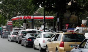 Drivers line up as they wait to buy petrol in Paris.