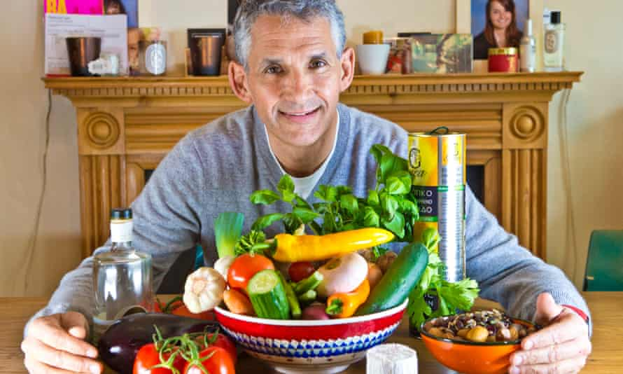 Professor Tim Spector at home with an overflowing bowl of vegetables