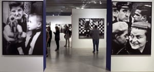 A visitor looks at works on display during the opening of the retrospective exhibition William Klein. Manifesto at the Telefónica Foundation in Madrid, Spain