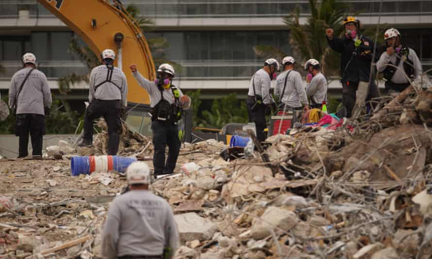 Search and rescue teams look for bodies in the rubble in Surfside, Florida, on 24 June.