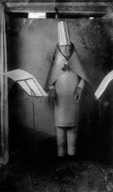 Hugo Ball, Dadaist writer and poet, here wearing a cubist suit made by himself and Marcel Janco for reciting of his poems at Cabaret Voltaire, Zurich, 1916.