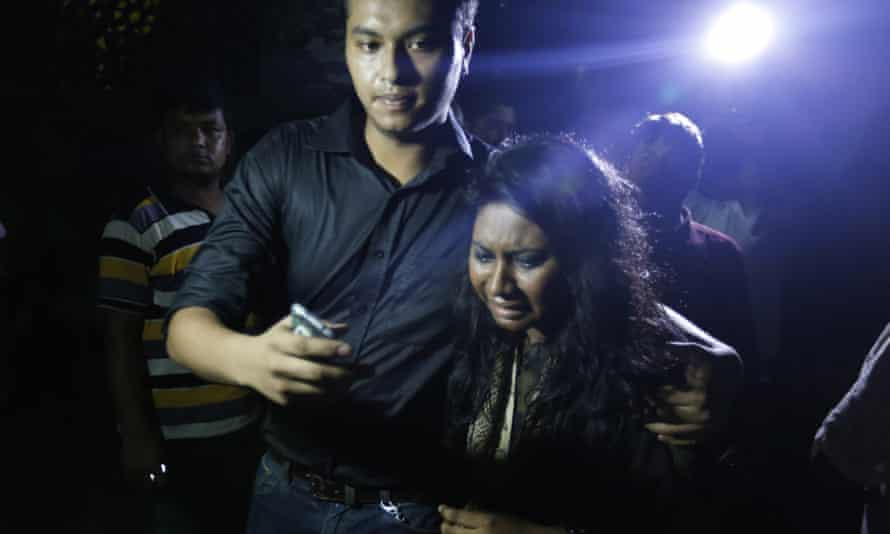 An unidentified colleague of Xulhaz Mannan weeps as she leaves the crime scene in Dhaka.