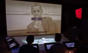 Visitors participate in an interactive exhibit about the raid to kill Osama bin Laden at his Abbottabad, Pakistan, compound at the International Spy Museum in Washington DC.