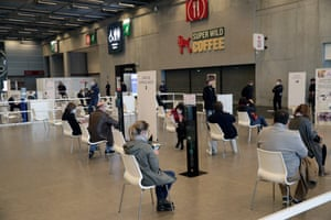 People wait at a vaccination centre set up at the Porte de Versailles convention centre in Paris, on 15 May, 2021.