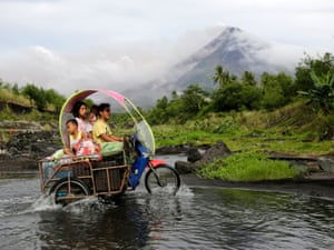 Albay, Philippines Villagers travel their belongings