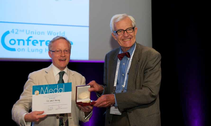 John F Murray, right, receiving the Union medal at the Union World Conference on Lung Health in Lille, 2011.
