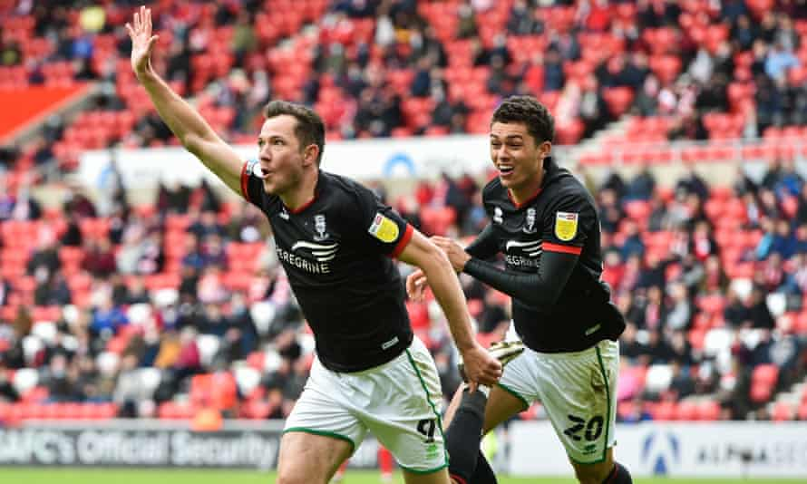 Lincoln's Tom Hopper celebrates scoring against Sunderland to help his side reach the League One play-off final.