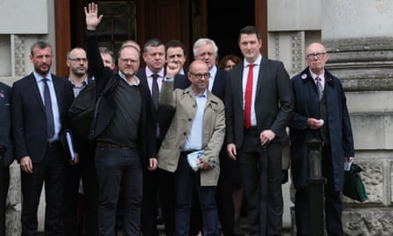 Journalists Trevor Birney and Barry McCaffrey outside the Royal Courts of Justice, Belfast, on 31 May.