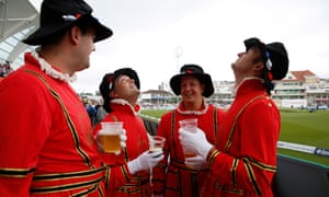 Four fans dressed as beefeaters