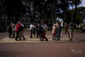 Couples dance the tango at a park amid the Covid-19 pandemic in Buenos Aires.