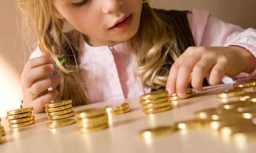 Girl counting chocolate money
