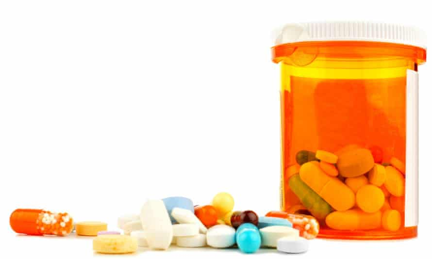 Pill bottle with various tablets