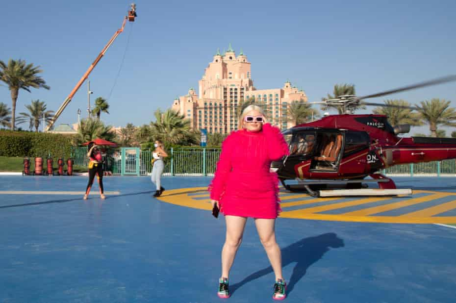 Influencer Busra Duran in front of a helicopter in Dubai