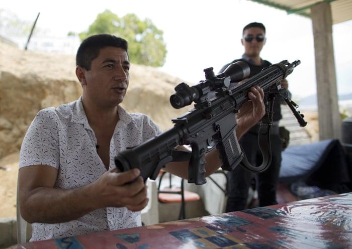 Mexico's vigilantes: violence and displacement – a photo essay