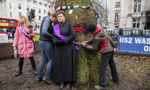Anne Stevens, vicar of St Pancras church, is chained to the doomed tree at Euston, central London.