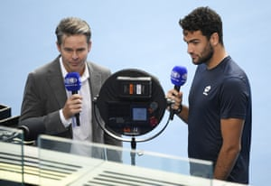 Italy's Matteo Berrettini, right, is interviewed by former Australian player Todd Woodbridge after he withdrew from his fourth round match against Greece's Stefanos Tsitsipas with an injury.