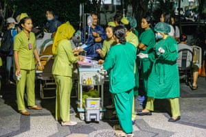 A hospital patient is moved outside of the hospital building after the earthquake was felt in Denpasar, Bali, Indonesia on 5 August