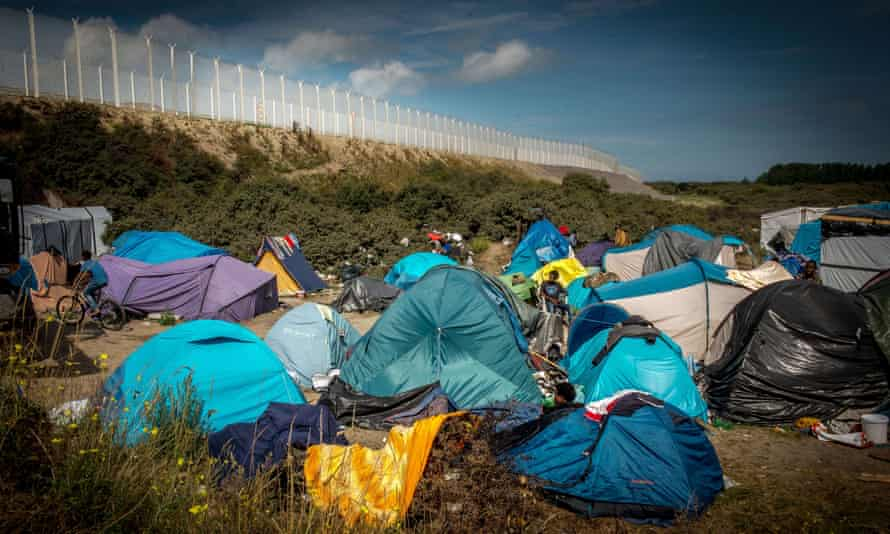 A migrant camp called New Jungle next to the fence of the ferry port in Calais, northern France