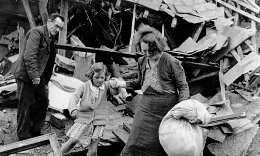 The Widdecombe family searching the rubble of their house in Plymouth after it was destroyed by German bombers in 1941
