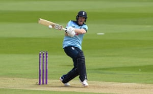 Eoin Morgan of England hits a boundary for four.