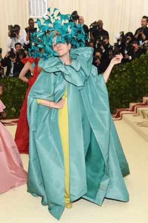 Leave it to Oscar-winning actor Frances McDormand to steal the show, with an enormous blue headpiece designed by Philip Treacy for Valentino Haute Couture. Her sumptuous turquoise cape and chartreuse gown ensemble is also by the Italian fashion house.