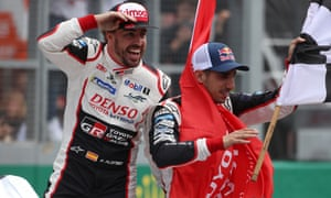 Fernando Alonso, left, and his teammate Sebastien Buemi oshow their delight after victory at Le Mans.