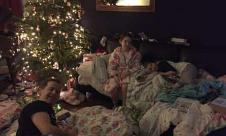 The Wolfe family sleeping under their Christmas tree