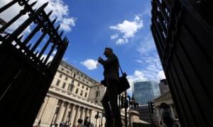 Pedestrians pass the Bank of England.