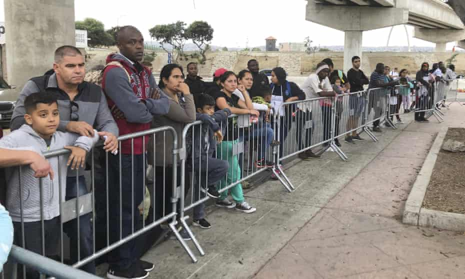 Asylum seekers in Tijuana, Mexico, listen to names being called from a waiting list to claim asylum.