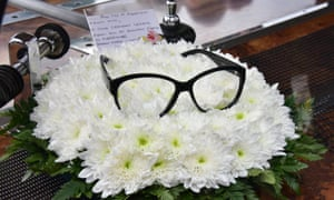 A wreath with a pair of Ronnie Corbett's trademark glasses was placed next to his coffin for his last journey.