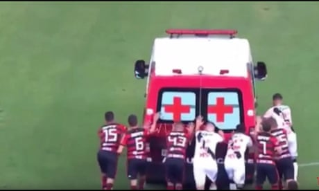 Footballers push ambulance from pitch in Brazil after it fails to start – video