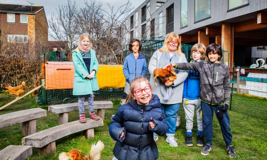 Stephanie Wilson with some of her 'helpers' next to the chicken run at Lauriston Primary school in Hackney, east London.