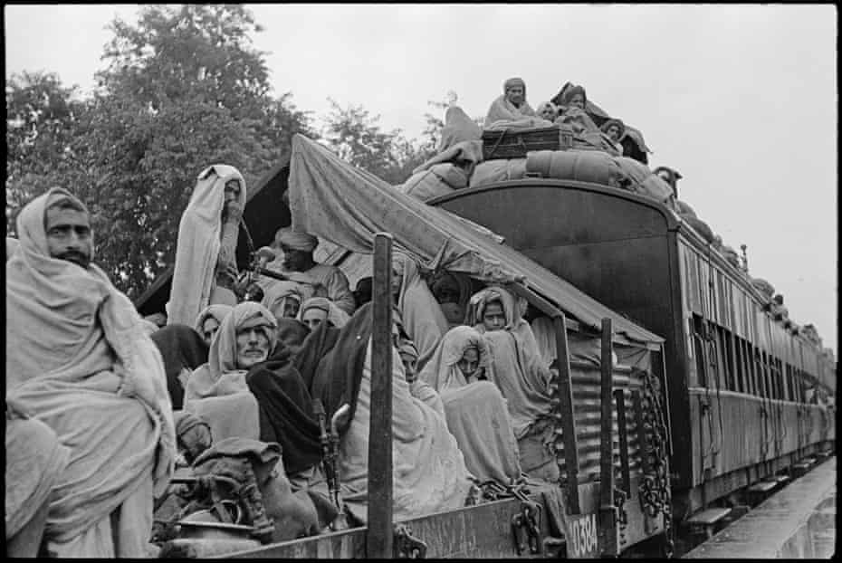A train carrying Muslims passes through the north Indian town of Kuinkshaha on its way from Delhi to Lahore, 1947.