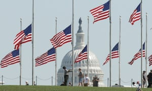 Flags on the grounds of the Washington Monument lowered to half-staff.