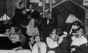 A group of patrons, many dressed as men in tuxedos, at Le Monocle, a famous night club for women in Paris.