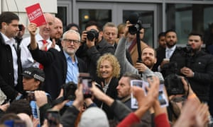 Jeremy Corbyn holds up Labour's manifesto in Swansea, December 2019.