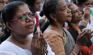Relatives of victims of last week's bomb blasts say prayers at Katuwapitiya church, Colombo, Sri Lanka