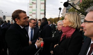 French president Emmanuel Macron shakes hands with Île-de-France head Valerie Pecresse.