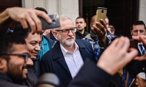 Jeremy Corbyn poses for a selfie with a crowd