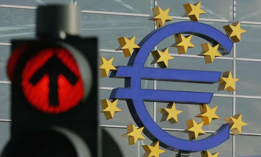 A huge euro logo next to a traffic light near Frankfurt airport