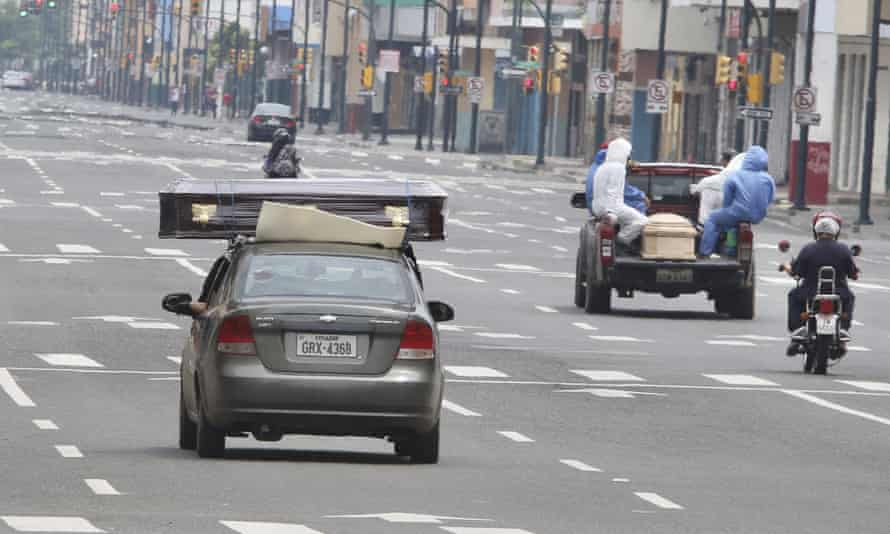 Makeshift hearses transport coffins containing the remains of people who are believed to have died from complications related to coronavirus to a cemetery in Guayaquil on 11 April.