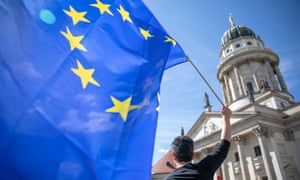 A participant waves the EU flag during a rally in support of the European Union in Berlin on Sunday