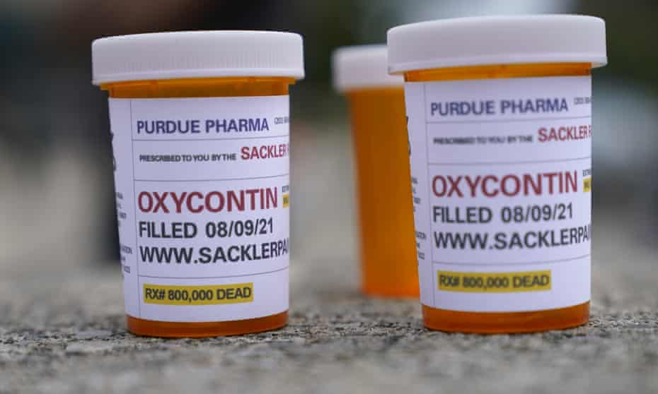 Fake pill bottles with messages about Purdue Pharma are displayed during a protest outside the courthouse where the bankruptcy of the company is taking place in White Plains, New York.